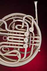 Silver French Horn Isolated on Red