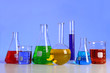 Laboratory Glassware Over Blue Background
