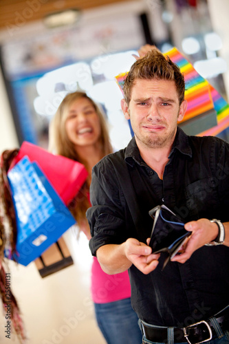 Shopping man with empty wallet