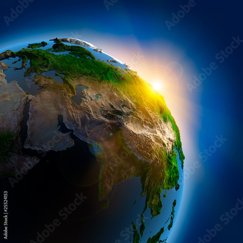 Sunrise over the Earth in outer space - 25524153