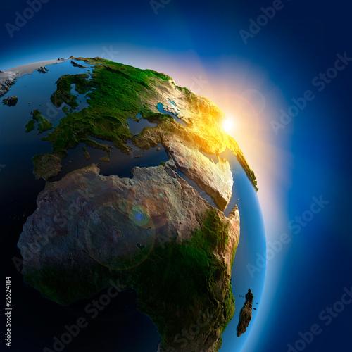 Leinwandbild Motiv Sunrise over the Earth in outer space