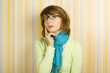 Beautiful young woman in glasses thinking