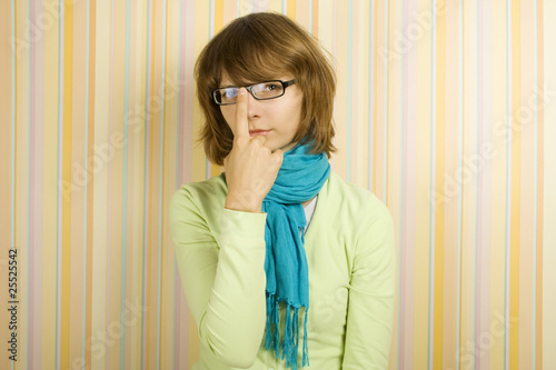 Beautiful young woman in glasses. Correcting glasses
