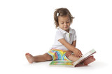 Toddler girl pretending to read a book poster