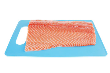 fresh uncooked salmon fillet on blue plate