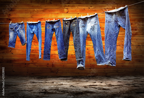 Jeans on a clothesline to dry on the grunge background - 25528102