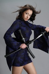 Beautiful girl dressed in China style holding a sword