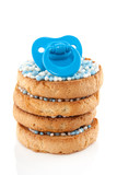 a blue baby's comforter on top of a stack of Dutch bicuits with
