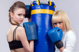 2 women involved in boxing poster