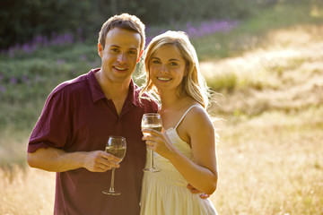 Portrait of a young couple drinking wine