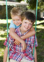 Portrait of two young Brothers in the garden