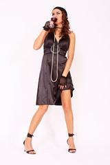 Attractive fashion model wearing elegant dress