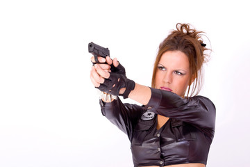 Police woman pointing the gun