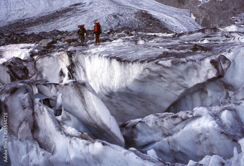 Alpinists and glacier slots, Alps