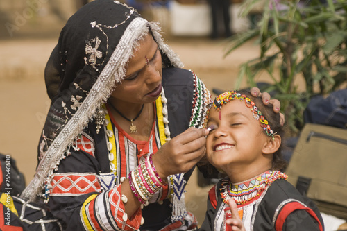 Young Rajasthani dancer gets make-up applied - 25546500