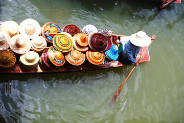 Vendor on floating market in Thailand