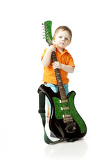 Little boy with a guitar on a white background