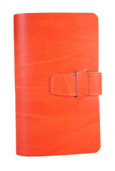 Small orange leather notebook on a white background