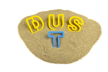 dust written on sand with colored letters