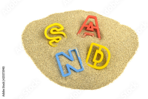 Written sand with colored letters on sand
