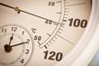 Leinwandbild Motiv Round Thermometer Showing Over 100 Degrees