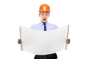 Surprised construction worker looking at project papers isolated