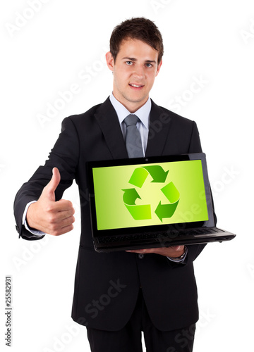 Young businessman holding laptop with recycle icon