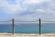banister railing on marine rope and wood