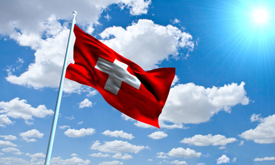 Swiss Flag in front of vivid, sunny, cloudy sky