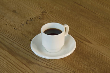 Close up of cup of espresso coffee on wooden table