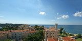 Panoramic landscape with the sky, the sea and rooftops poster