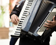 Street musician, accordion playing