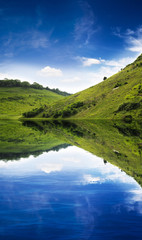 Green hill reflection
