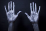 beautiful male hands in silver paint