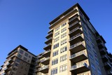 A high rise commercial apartment, condominium building. poster