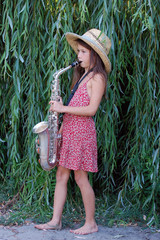 Teen girl with saxophone