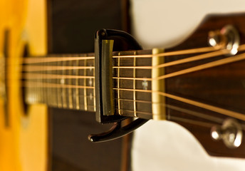 Capo on a acoustic guitar
