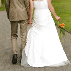 Closeup of bride and groom walking