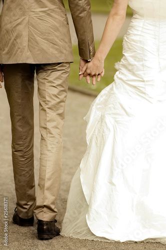 Closeup of bride and groom walking