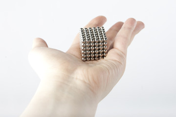 Cube assembled from metallic magnetic segments