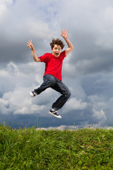 Boy jumping, running outdoor