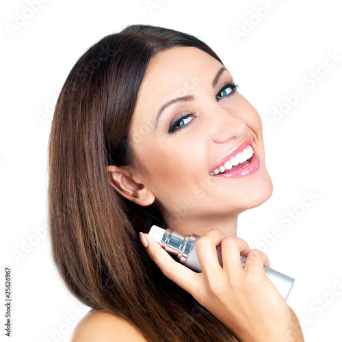 Portrait of beautiful woman she is holding bottle of perfume