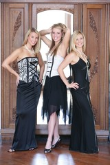 Three Teenage Girls Dressed In Formal Wear