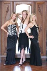 Three Teenage Girls Dressed In Formal Wear