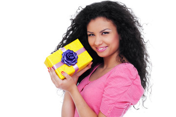 pretty woman holding small yellow gift