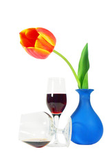 Isolated still life with a vase, red tulip and tall wineglasses