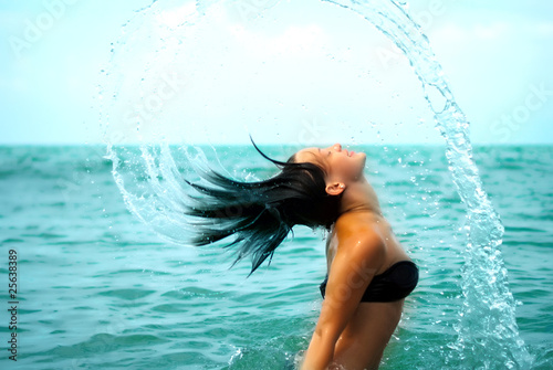 splashes. Girl in the sea