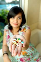 Asian Pregnant Woman and Medication Pills