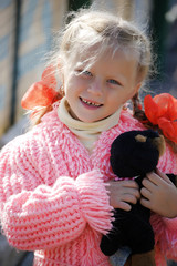 Smiling little girl with toy dog