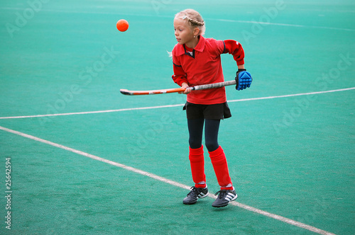 Field hockey girl in red